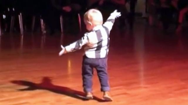 Baby hears favorite song come on, starts to dance the jive, but his ending cracks everyone up