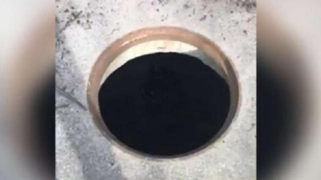 Man walking in the woods hears a cry for help coming from manhole