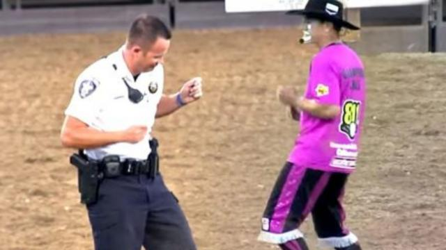 Rodeo Clown challenges police officer to hysterical dance-off,