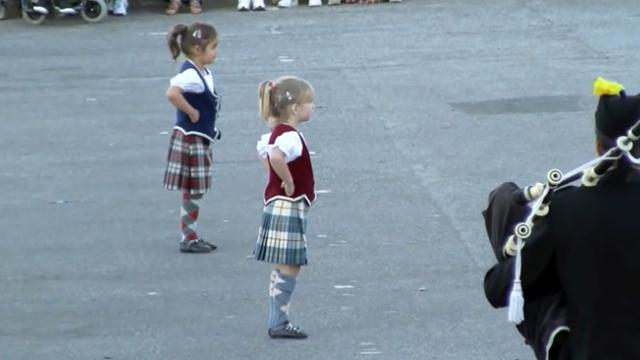 Tiny girls prepare to dance: as music starts crowd's eyes glued to their feet