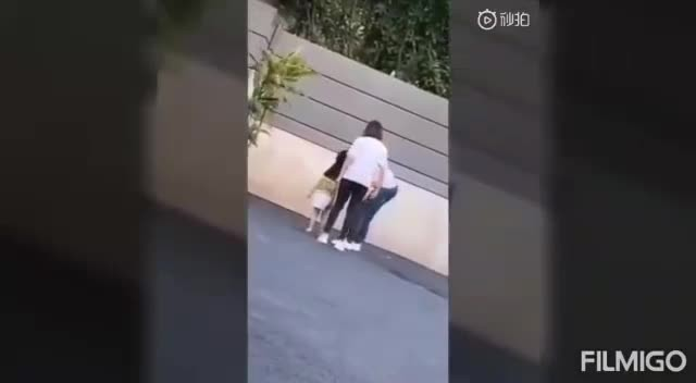 Video shows mother kicking 3-year-old child model daughter for misbehaving during shoot