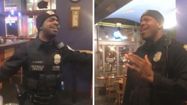 Two police officers serenade patrons at restaurant with Ed Sheeran song