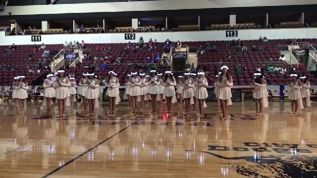 High school dance team lines up in gym - crowd goes wild when lights go out