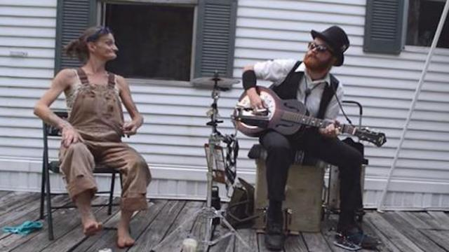 Man plays guitar when barefoot lady joins for captured performance making everyone's mouth hang