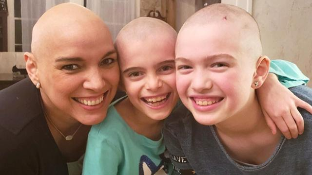 Young daughters shave heads to support their mother battling breast cancer