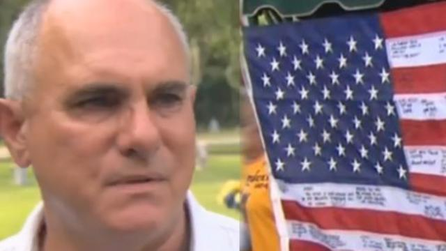 Man discovers $5 flag at flea market but close look at writing on it makes his heart drop