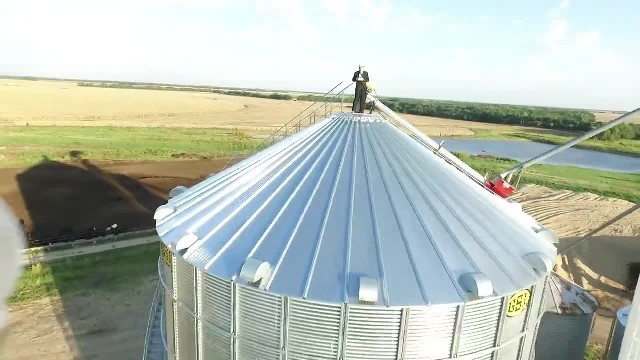 Choir sings 'Down To The River To Pray' in grain silo