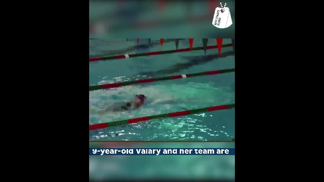 Nine-yr-old breaks down when Navy brother crashes swim meet, then she goes for gold