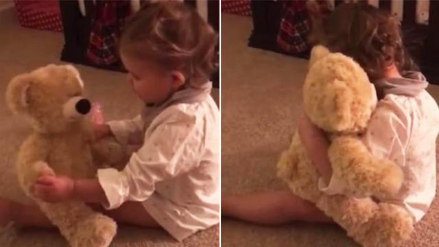 Baby girl gets bear from deployed daddy and flips out when she grabs its hand