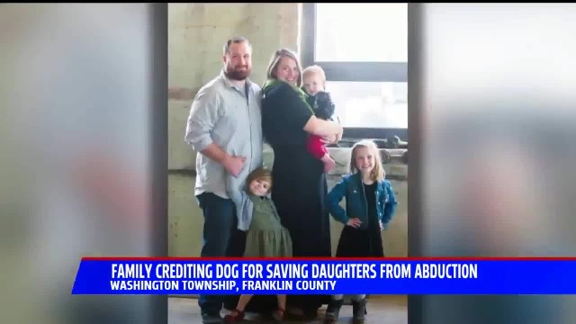 Parents credit family hound for thwarting the possible kidnapping of their 3 daughters