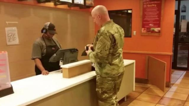 Soldier is paying for his food but when 2 boys walk in and say they're starving, he changes his mind