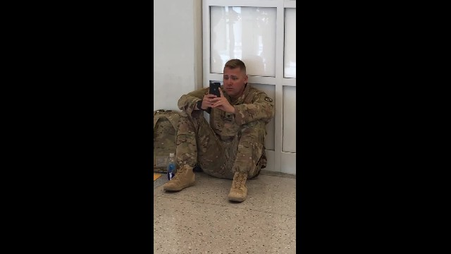"Airport staff hear ""Don't let him board the flight"" only to spot soldier crying at sight on phone"