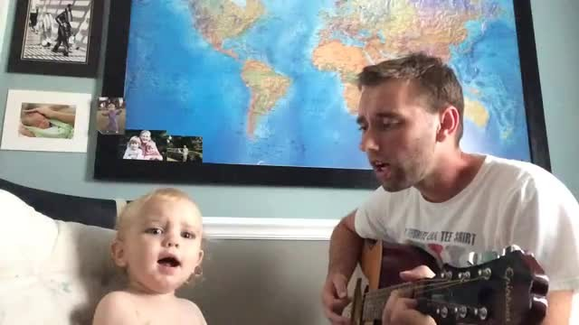 Dad strums guitar and begins to sing, but son steals show the moment he opens his mouth
