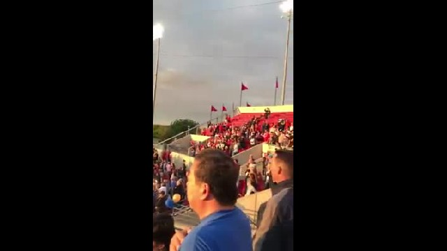 Announcer says that the national anthem won't be played, then crowd joins together to sing it