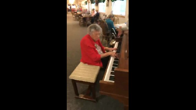 A 103 year old woman sits down at a piano. Now the footage is going viral