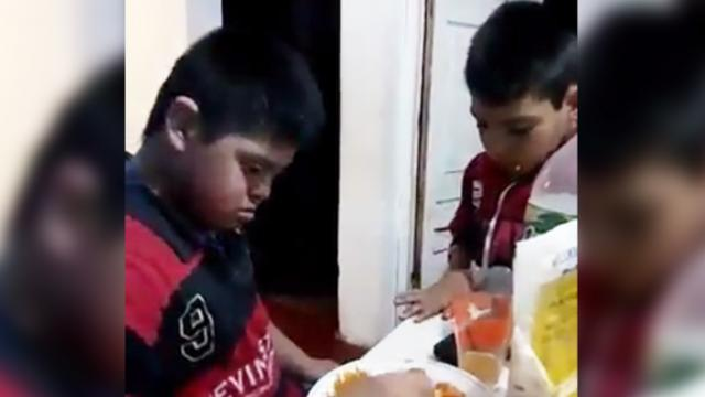Boy with Down syndrome feeds his autistic friend, and we're loving the sweet moments they share!