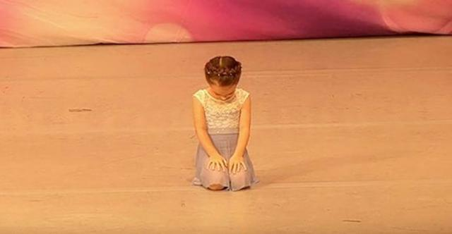 Tiny girl gets ready to dance, only to look up and melt everyone's heart