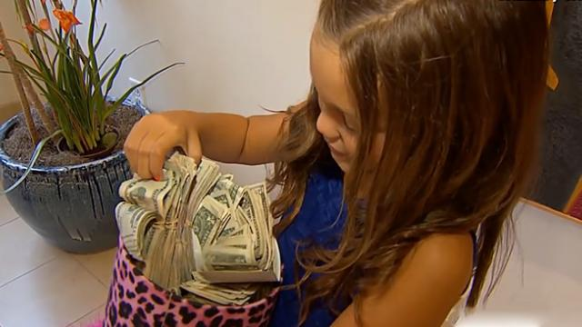 Little girl comes home with stack of money and people are asking for an explanation