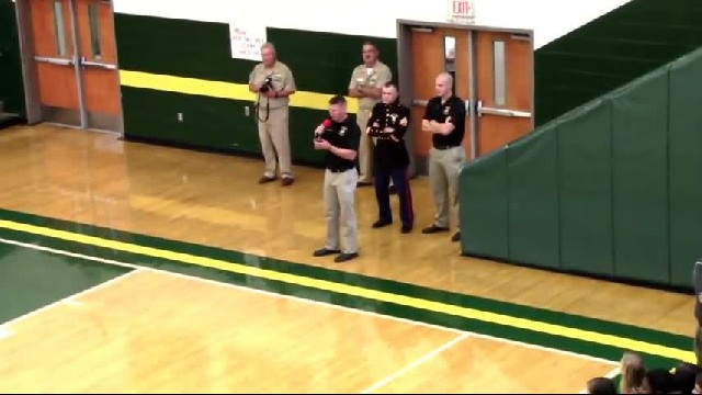 Twenty-four Marines mesmerize high school with elaborate drill routine in total silence