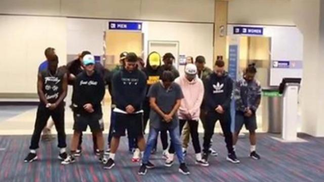 Dancers are stuck in airport for 6 hours, have all the passengers cheering with wild routine