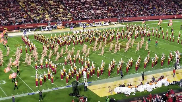 "Marching band gets hilarious halftime dancers during ""Jurassic Park"" theme song."