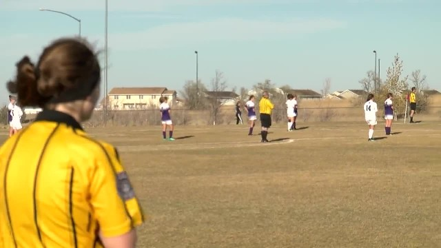 Girls and referee freeze during soccer game as everyone hears unmistakable sound