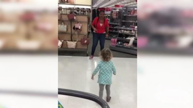 Target employee challenges little girl to a dance off