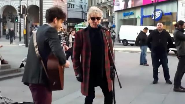 Superstar Rod Stewart Hears Street Performer Play His Song, Grabs