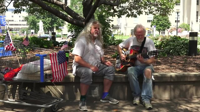Homeless Man Strums 'Hallelujah' But When Partner Opens Mouth People Stop In Their Tracks