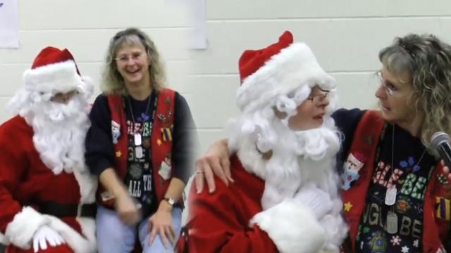 Clueless teacher sits in santa's lap and has no idea who it is until he pulls down his beard