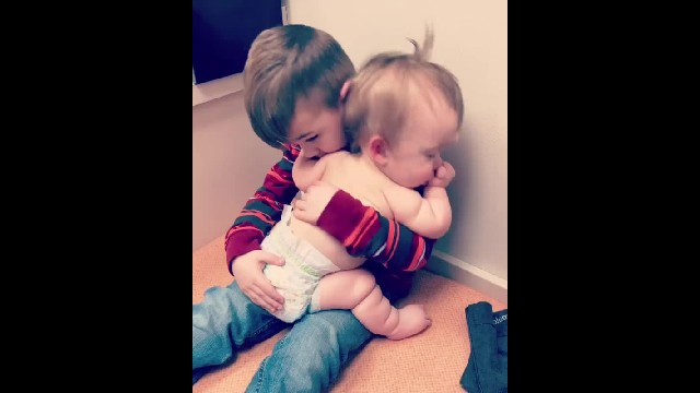 Big brother comforts baby sister at doctor's office - when mom sees it, she runs to grab phone