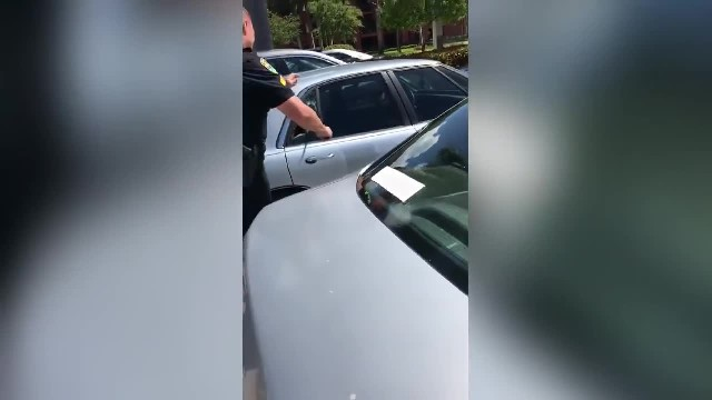 Police Officer Breaks Car Windows To Save Pit Bull Trapped In A Hot Car