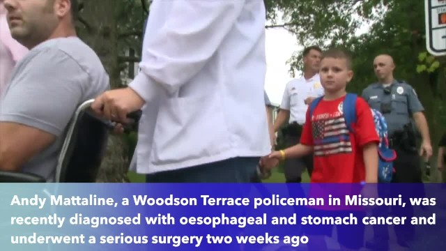 Missouri police officer with cancer walking his autistic son to his first day of school along with a