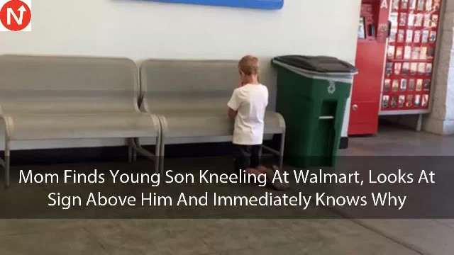 Mom finds her son kneeling to pray in Walmart. Looks at blue board hung on wall above him and gasps
