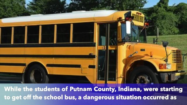 Indiana driver ignores school bus stop arm while students starting to get off bus