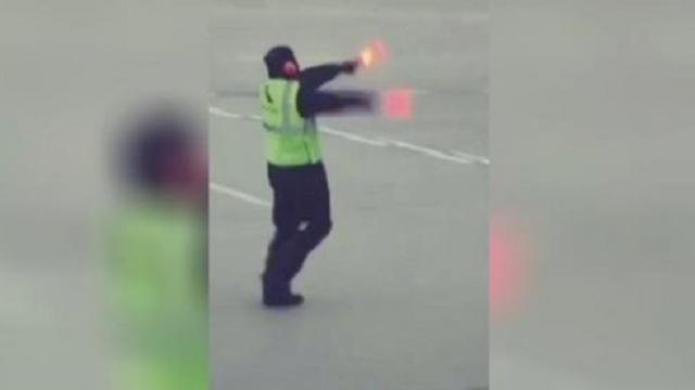 Airline employee dances to cheer up crying child