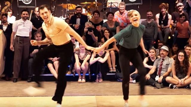 Husband & wife swing dancing couple wows crowd with silky smooth 1950's routine.