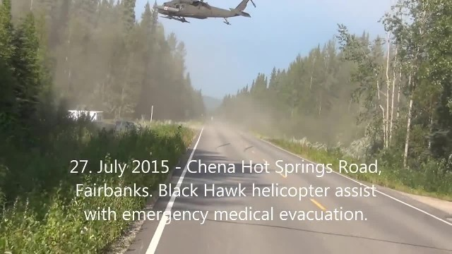 Shocked motorists watch black hawk helicopter land on highway to save a life