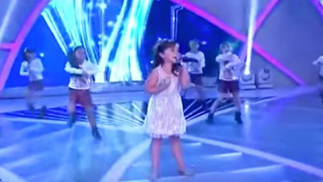 Tiny girl takes stage with dancers. In seconds, her huge voice knocks everyone out