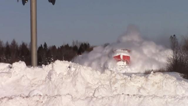 Speeding train collides with wall of snow