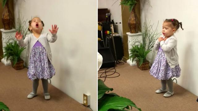 After hospital scare tiny girl raises her arms to sky, melting everyone's heart with song choice.