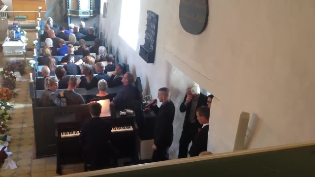 Little brother singing his version of 'Raise me up' at his brothers funeral