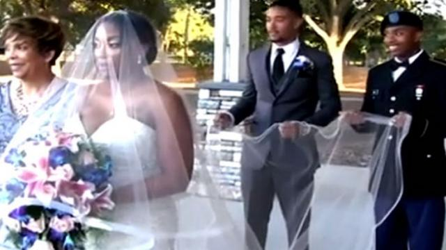 Soldier surprises mom as she's walking down the aisle & her reaction is priceless.