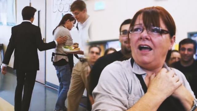This lunchlady was suspicious of the student in the tuxedo. Then he tapped her on the shoulder