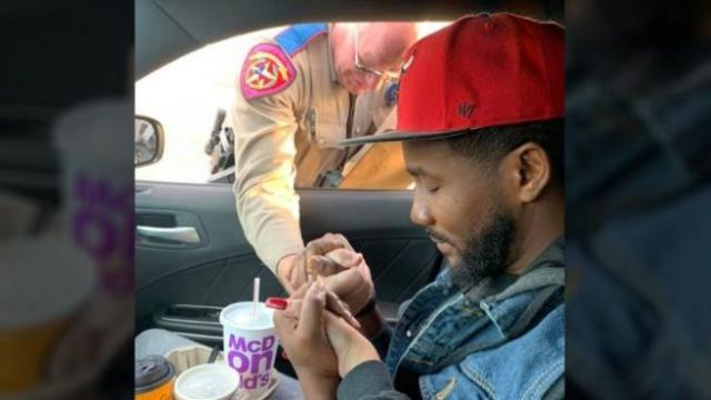 Texas DPS trooper prays with couple he pulled over on the way to a funeral