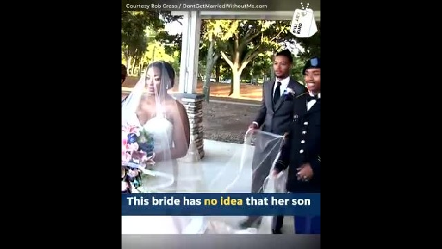 Soldier surprises mom as she's walking down the aisle & her reaction is priceless