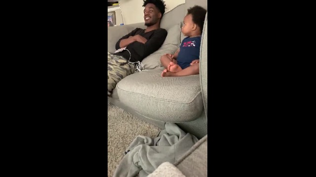 Dad chatting with infant son about TV finale is the cutest thing on the internet this week