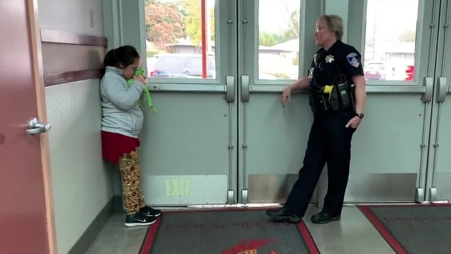 Girl has meltdown in hallway when officer approaches making headlines with tactic principal can't ig