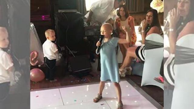Bittersweet moment when cancer-stricken 6-year-old sings at family friend's wedding