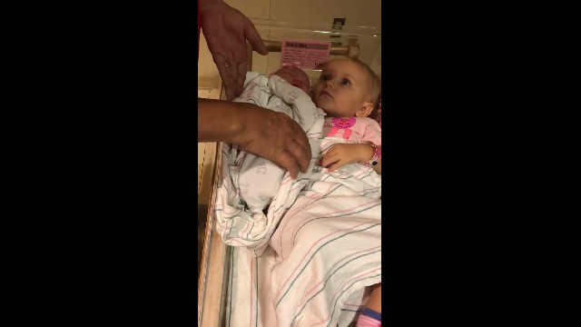 Elder Sister Refuses To Let Go Of Her New Baby Sister, Shaking Her Head When Anyone Comes Close